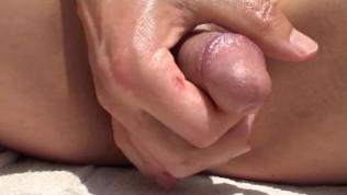 Erotic penis massage in the sun